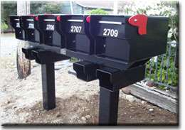 Fortress mailboxes shown on a custom steel rack by Fort Knox Mailbox