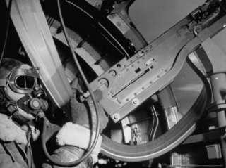 Robert G. Nichols Manning His 50 Cal. Machine Gun in the American B 17