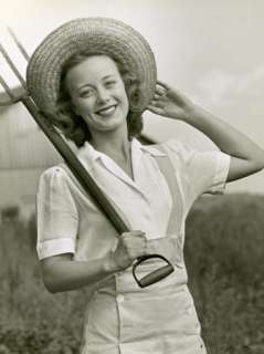 Young Farm Woman With Pitchfork Photographic Print by George Marks at