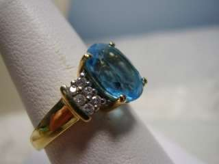 Beautiful Blue Topaz and Diamond Ring Done in 14K Yellow Gold